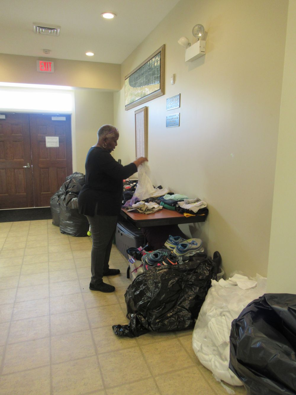 Micah Center-sorting donations